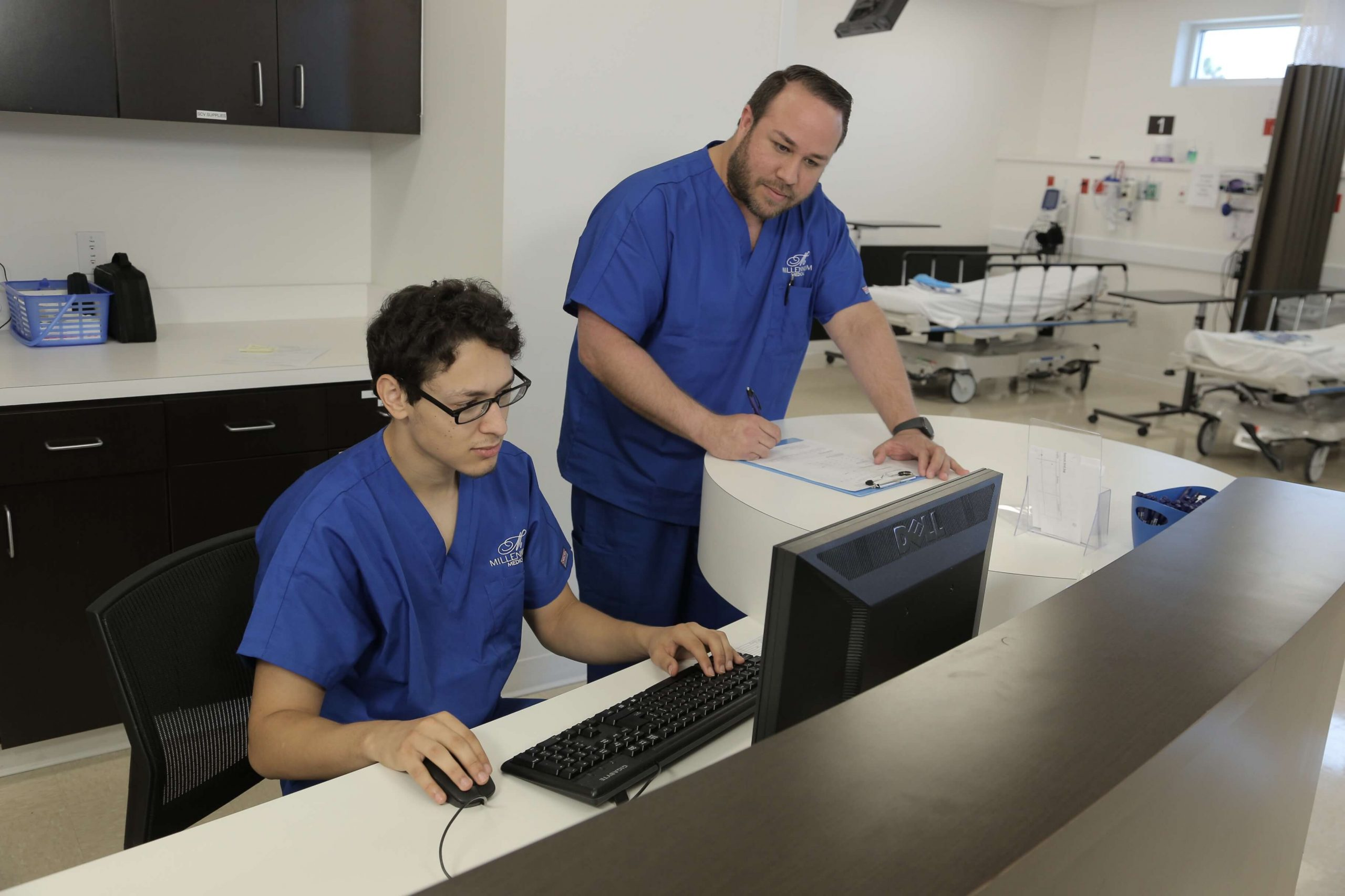 Physicians working on computer