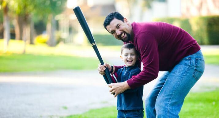 Man and Son with Baseball Bat
