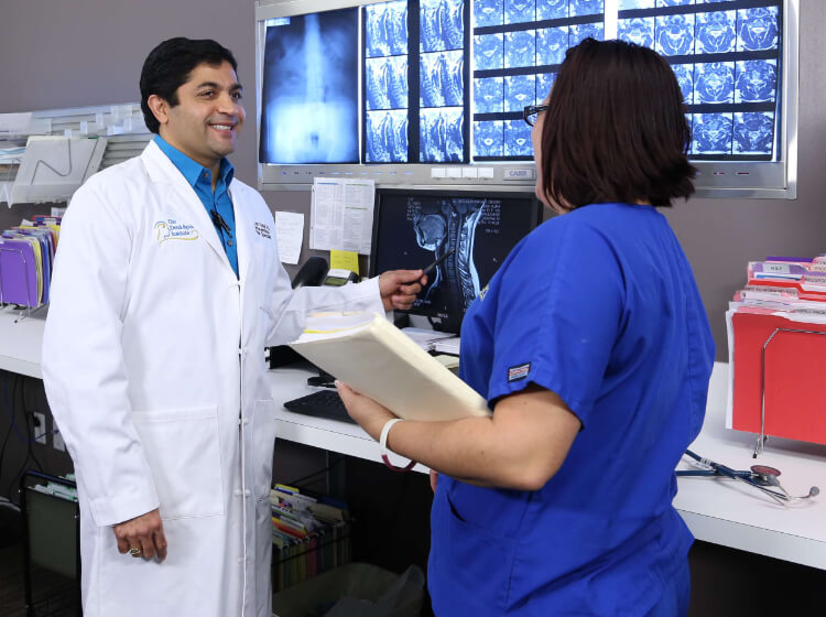 Dr. Patel communicates with his staff and patients.